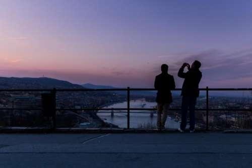 sunset dusk silhouette people sky