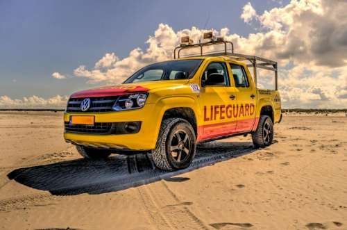 lifeguard truck beach sand yellow