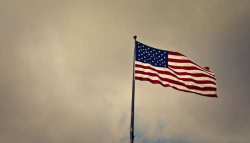 waving american flag star & stripes cloudy