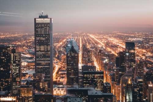 city lights buildings dawn city architecture cityscape