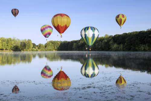 hot air ballons colorful sky flight reflections
