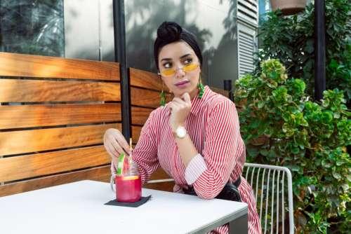 woman pink drink sunglasses fashion