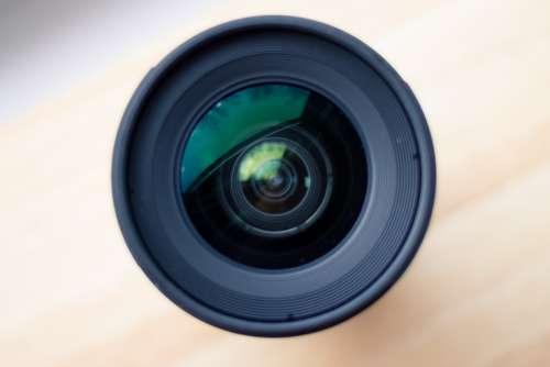 black camera lens photographer photo