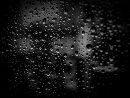 black dark glass window wet