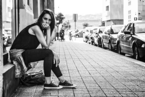 black and white woman girl alone sitting