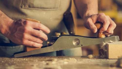 carpenter working wood cut man
