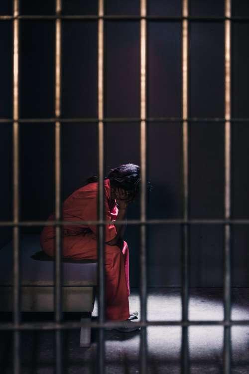 woman prison jail imprisoned justice