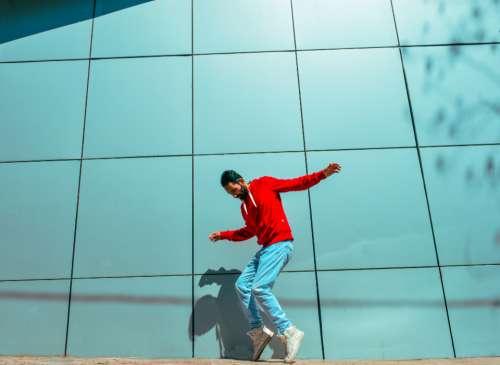 man casual dance pose portrait