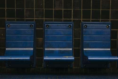 chairs subway platform bench blue
