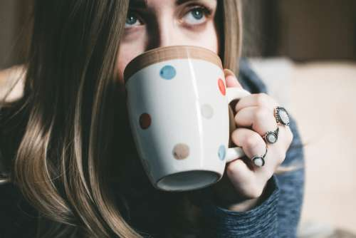 woman drinking coffee morning drink