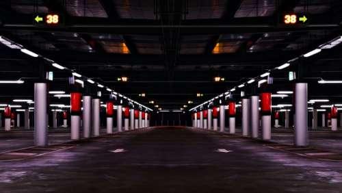 parking garage pavement arrows pillars architecture