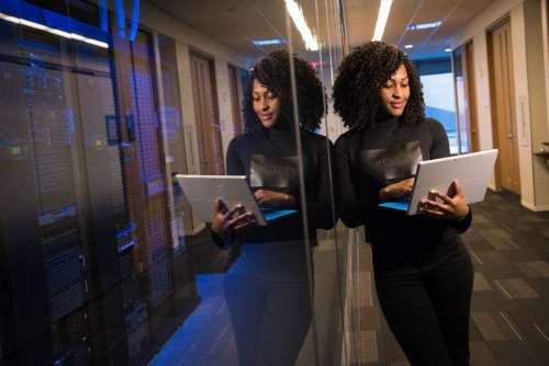 servers woman laptop work business