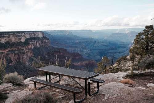 Picnic bench overlooking Grand Canyon, Arizona, USA