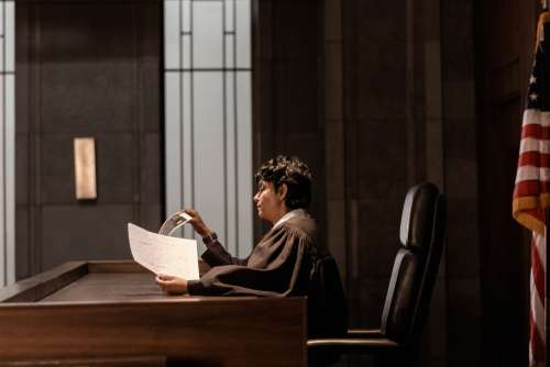 A Judge Reviewing Evidence In Court Photo