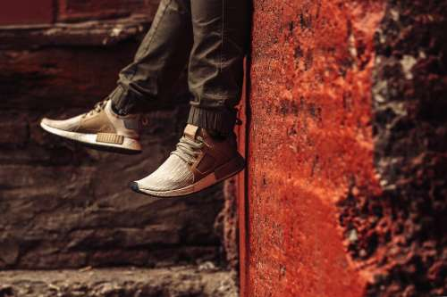 Beige Trainers In Front Of Red Wall Photo