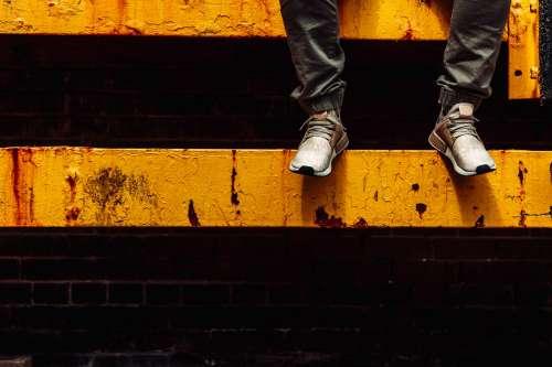 Feet On Yellow Beam Photo
