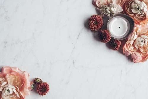 Flowers On White Marble Table Photo