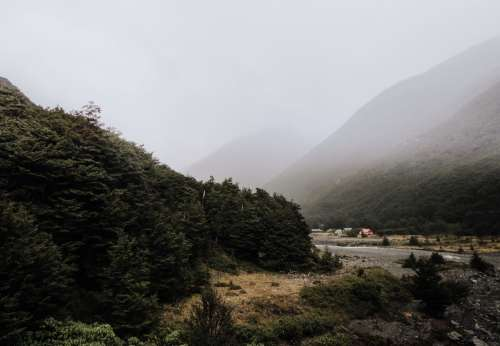 Misty Mountain Valley And A Huddle Of Woodland Huts Photo