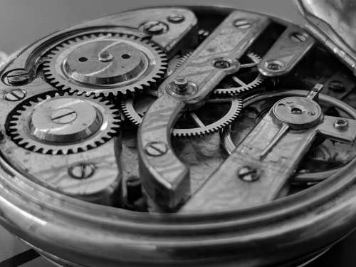 Open Timepiece Exposing Cogs And Gear Wheels Photo