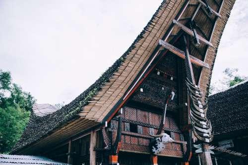 Ornate Indonesian Bamboo Temple Towers Overhead Photo