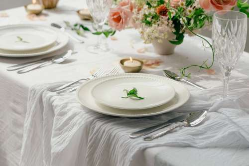 Place Setting On White Table Photo