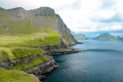 Pristine Mountainous Coastline Off Faroe Islands Photo