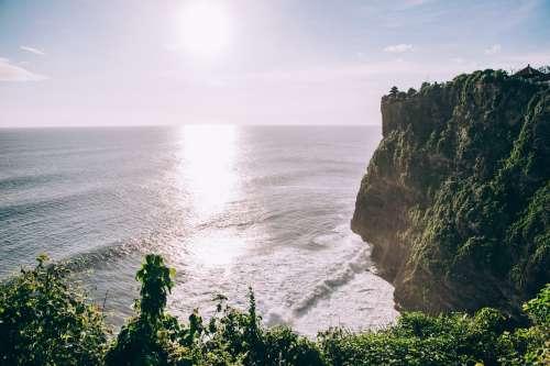 Rocky Cliffs Of Coastline Covered Lush Jungle Photo