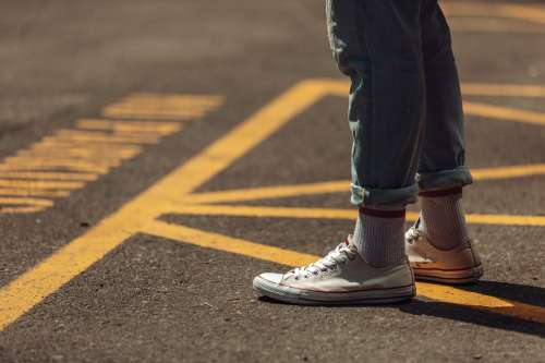 Wearing Sneakers On Road Photo