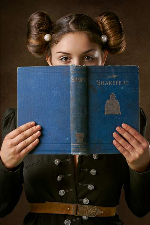 Young Woman Holds An Antique Book Photo