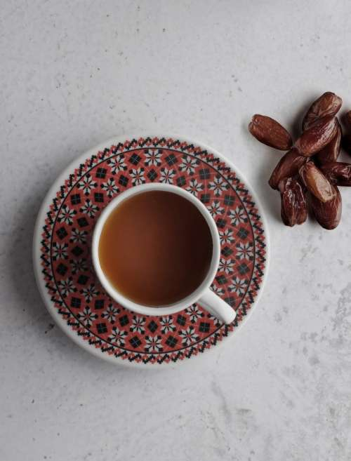 Cup of coffee with dried dates