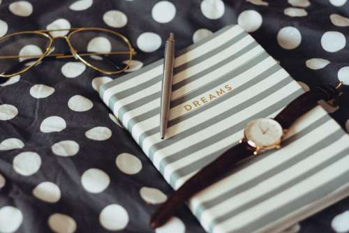 Dreams notebook and wristwatch