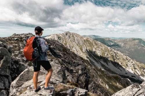 Active hiker enjoying the view. Summer mountain view.
