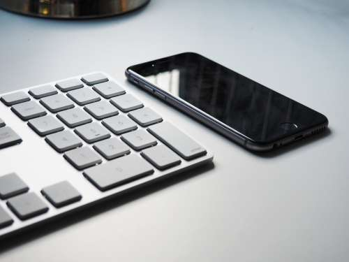 Keyboard and iPhone on Desk