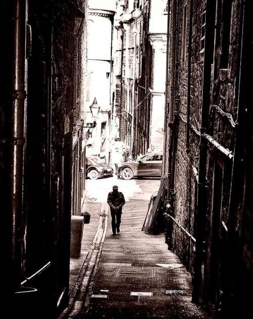Edinburgh Darkedinburgh Scotland man alone