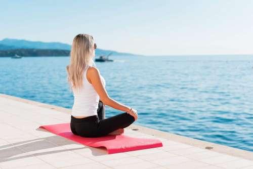 Woman Enjoying Sun During Morning Yoga Free Photo