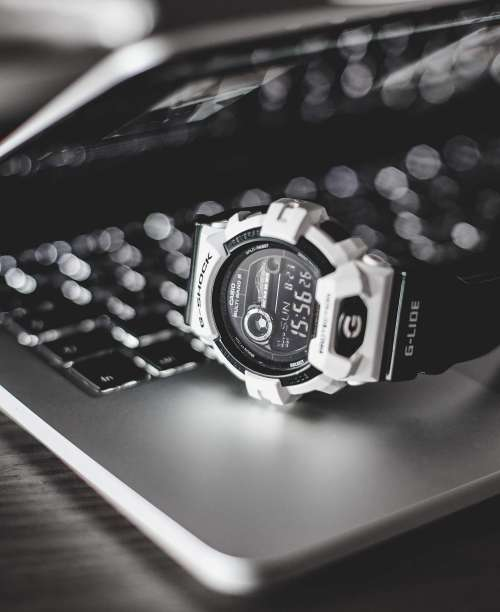 G-Shock Watches on Laptop Free Photo