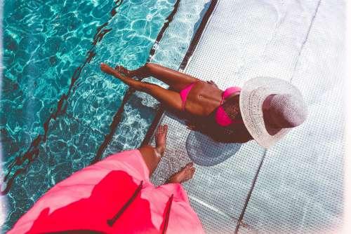 Man Looking at His Sexy Fitness Woman in Bikini Free Photo
