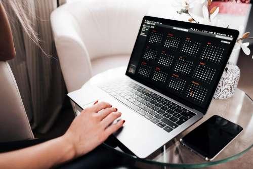 Woman Planning Her Calendar Free Photo