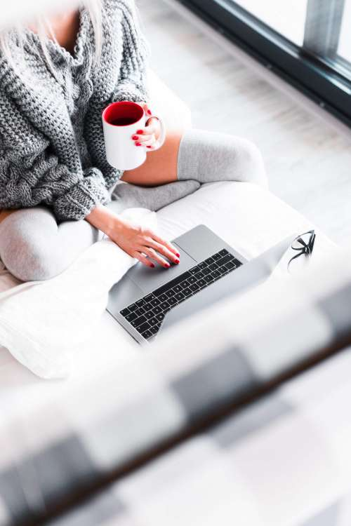 Woman Working from Her Bed with Laptop Free Photo