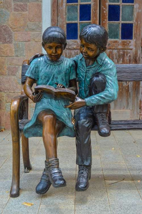 Boy And Girl Reading On The Bench Nicely Italy