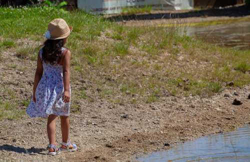 Child On Pond Shore Child In Hat Child Hat