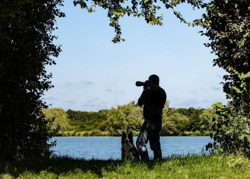 Photographer Male Photographer Man And Dog Lake