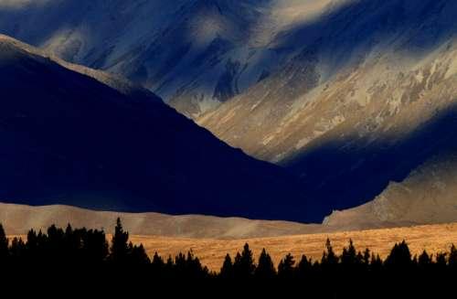 mountains trees sun sunlight sunset