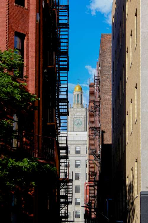 city fire escape buildings alley
