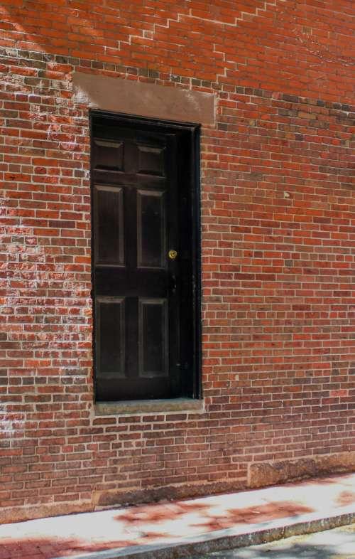 brick wall door sidewalk street