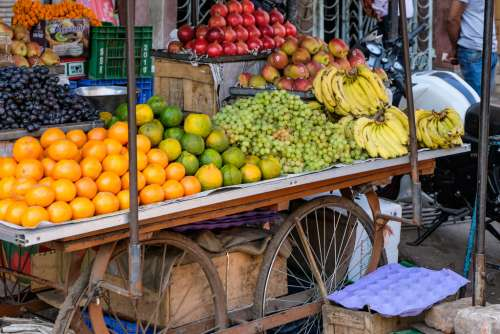 Street Vendor Selling Fruits on His Fruit Cart