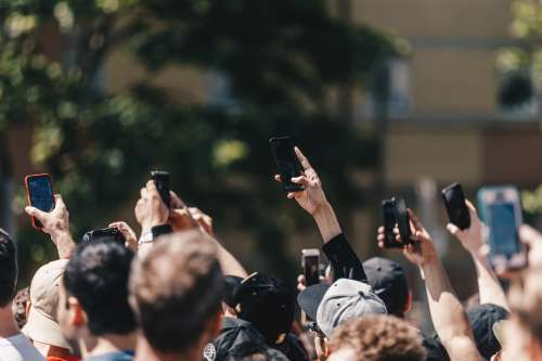A Protest In the Street Holds Up Mobile Phones Photo