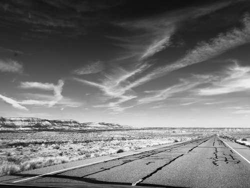 A Sun-Cracked Highway Through The Desert Photo