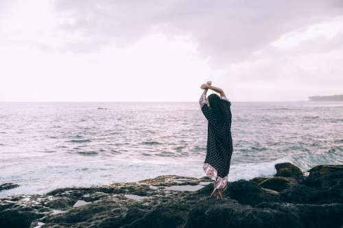 A Woman In A Beach Robe Poses On The Beach Photo
