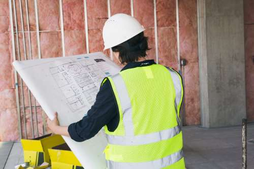 Construction Worker Holding Blueprints Photo